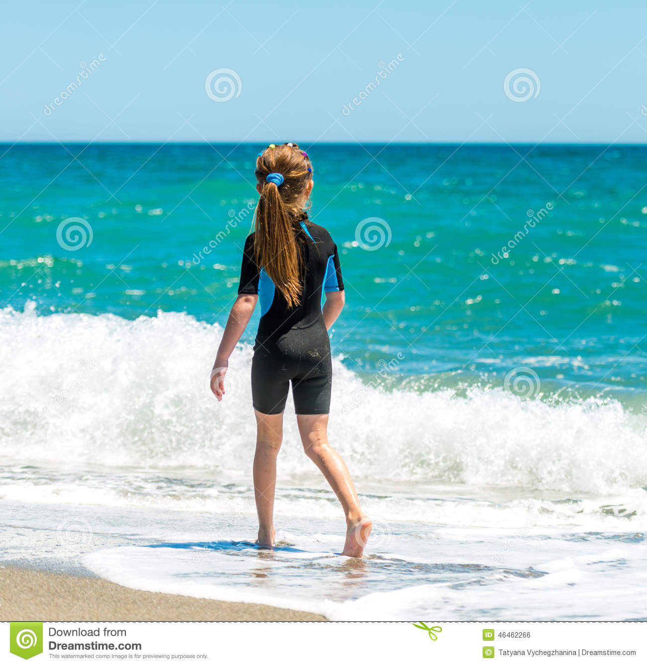 b314923c33 Girl In A Wetsuit Running Along The Beach Stock Photo - Image of ...