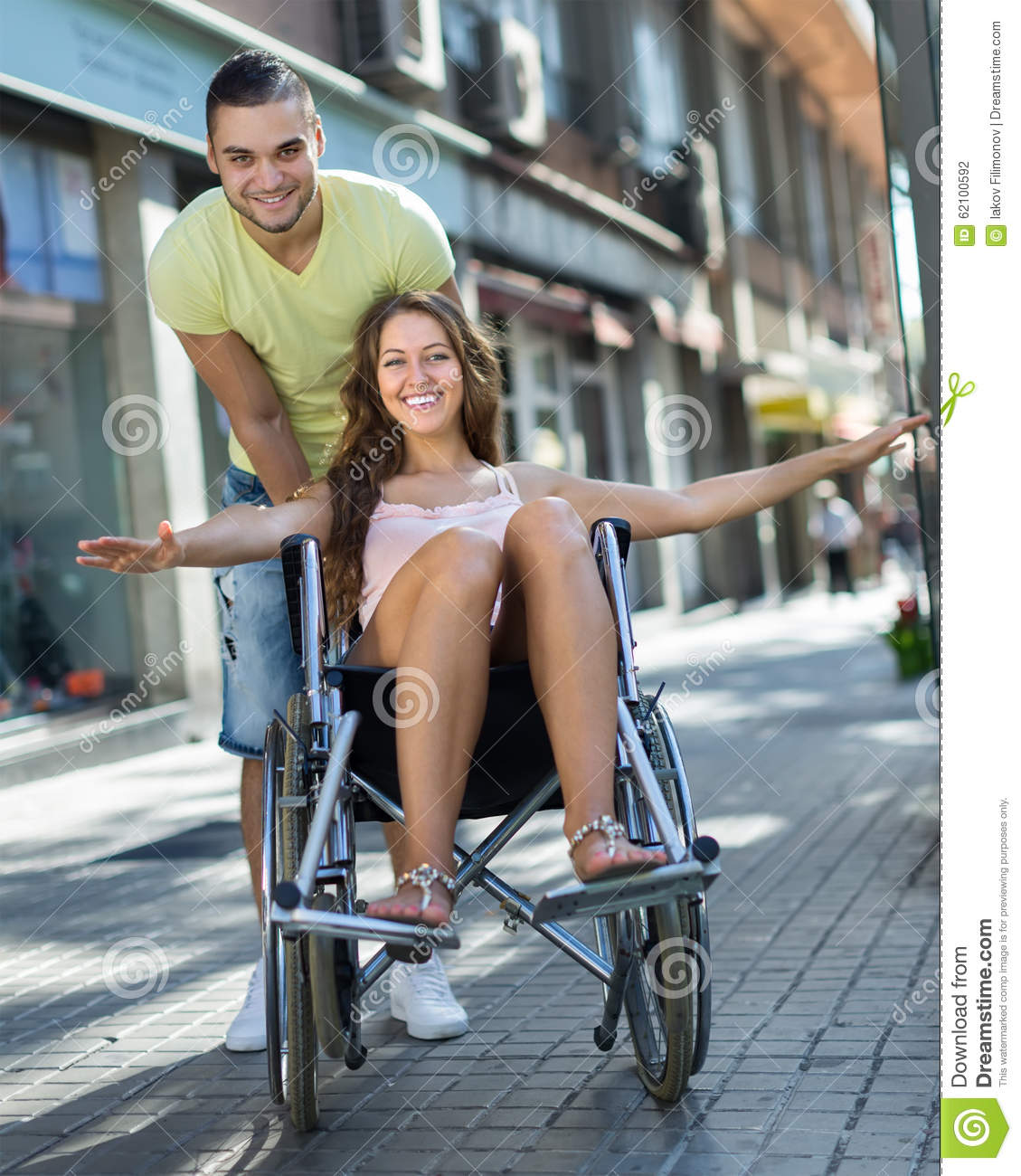 image Paraplegic girl dance outside wheelchair