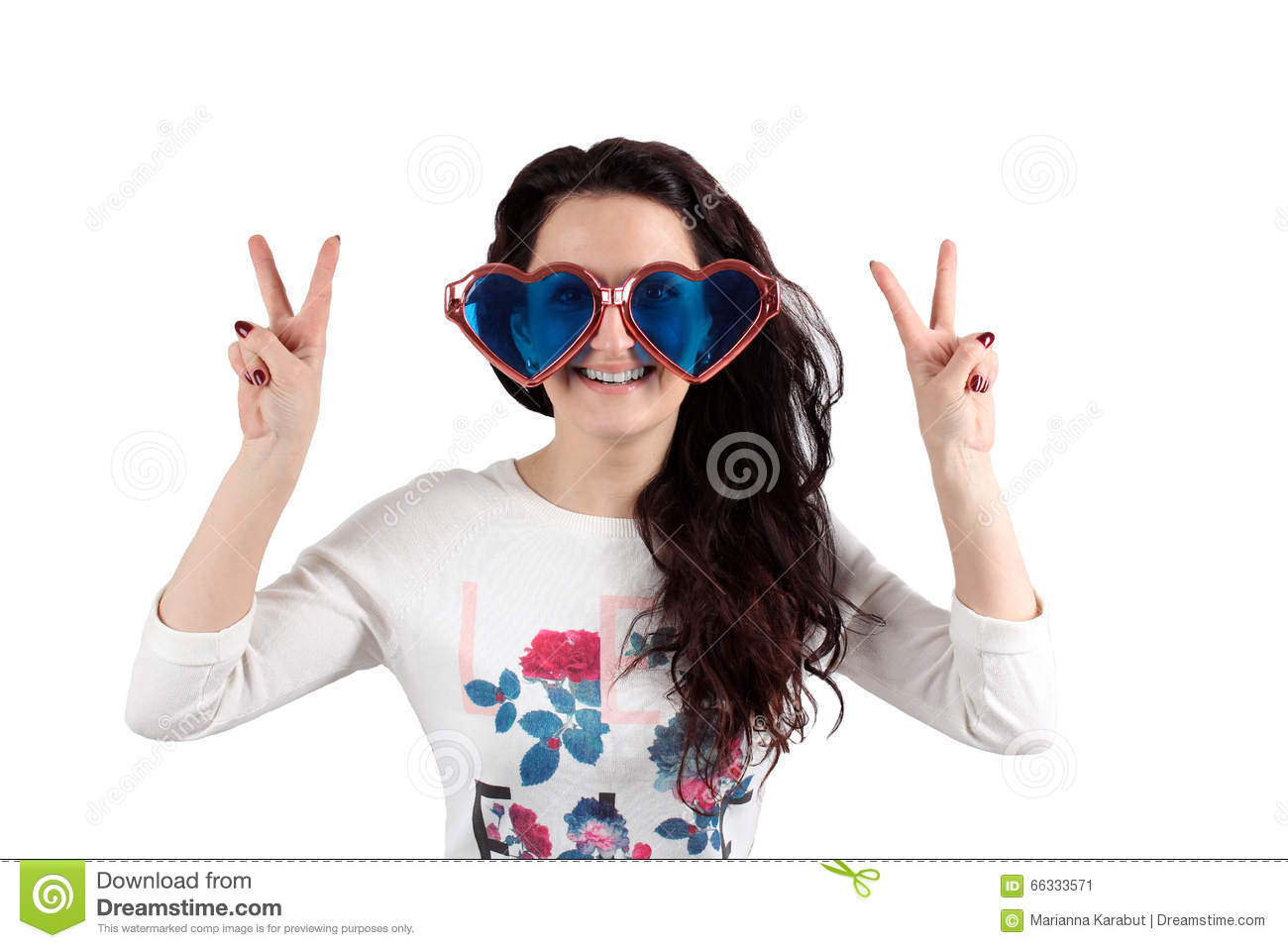Girl on a white background with big glasses and her hands up.