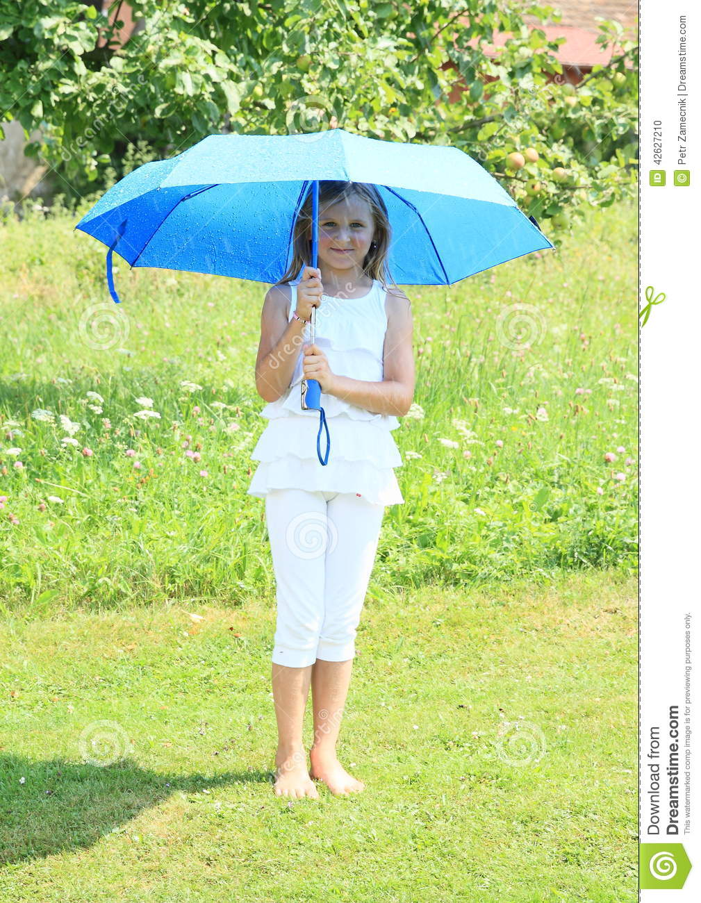 girl in white with blue umbrella stock photo   image 42627210