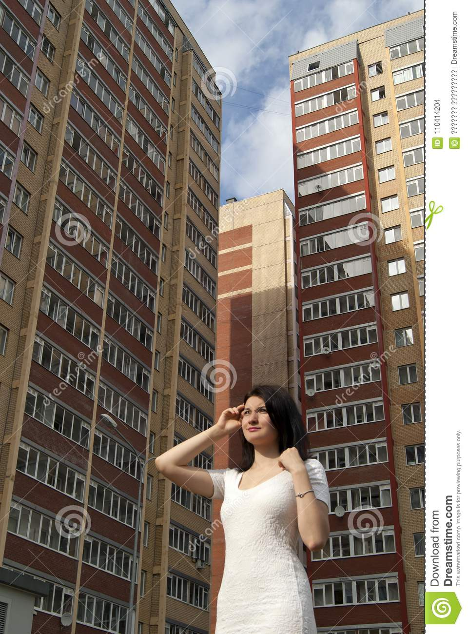 girl on the background of multi-storey buildings
