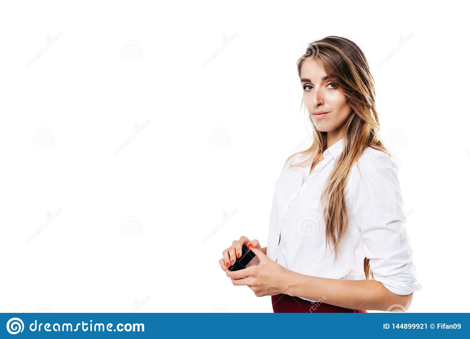 Girl in white shirt and burgundy skirt on an isolated white background