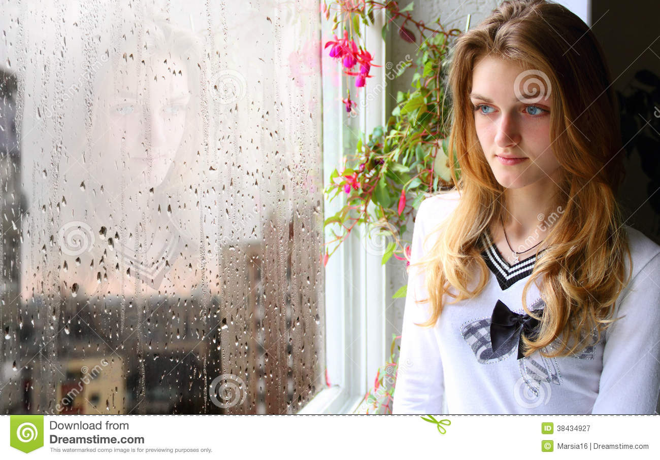 Girl at the Window in the Rain