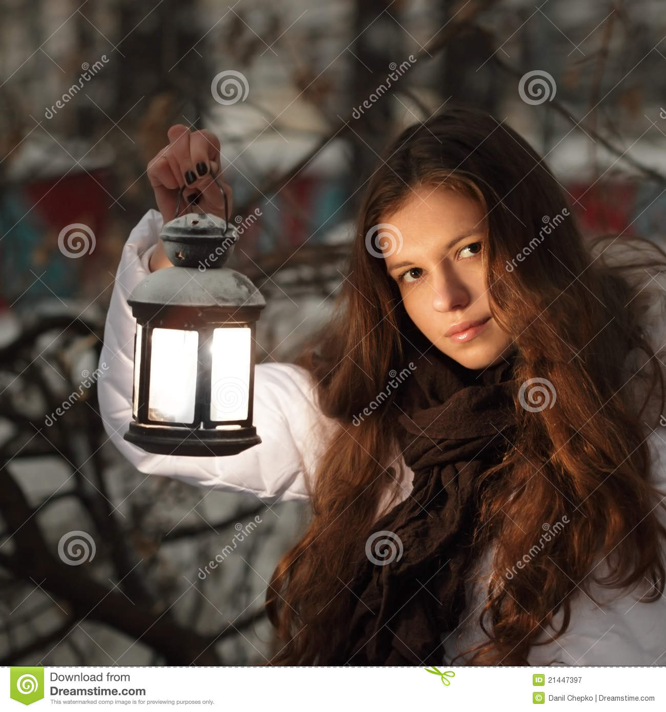 Girl on winter forest with lantern