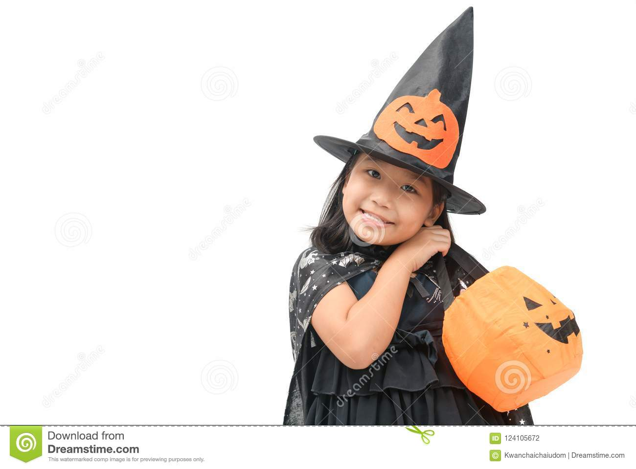 30bf933f81c Funny child girl in witch costume for Halloween with pumpkin Jack isolated on  white background
