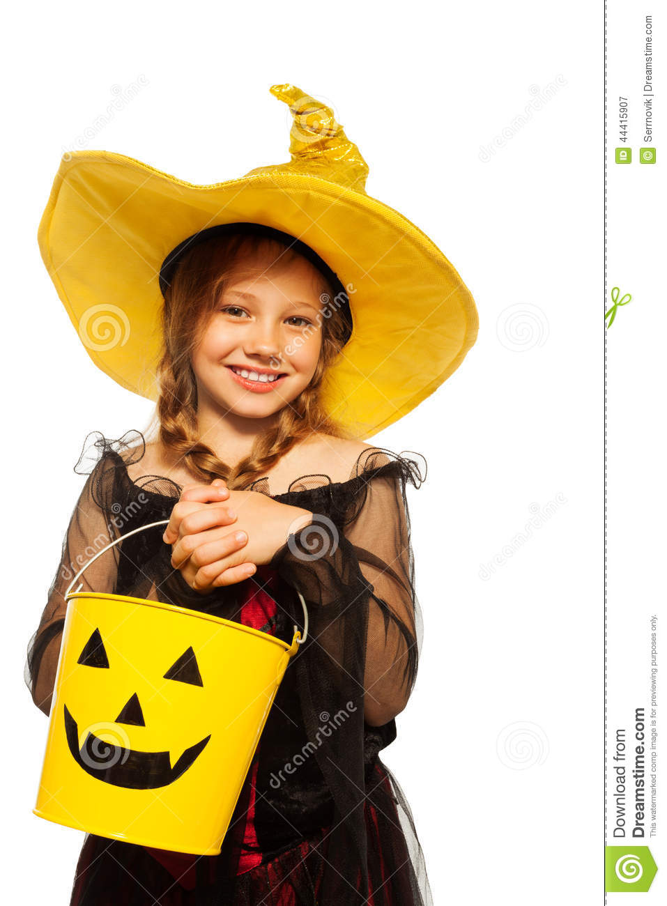 Girl In Witch Costume And Spooky Halloween Bucket Stock Image