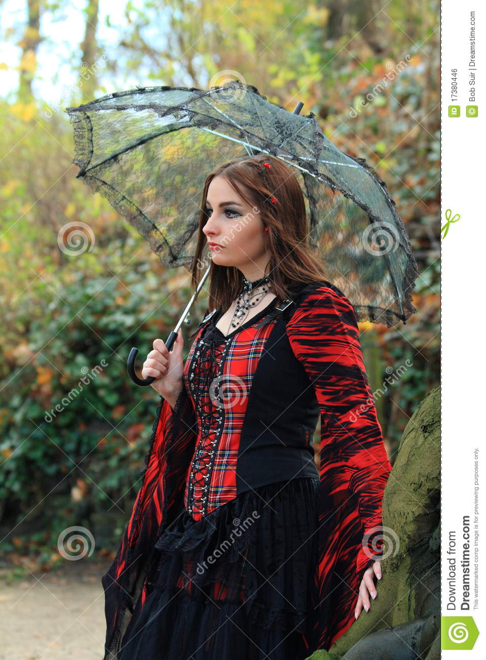 Girl in the woods with umbrella