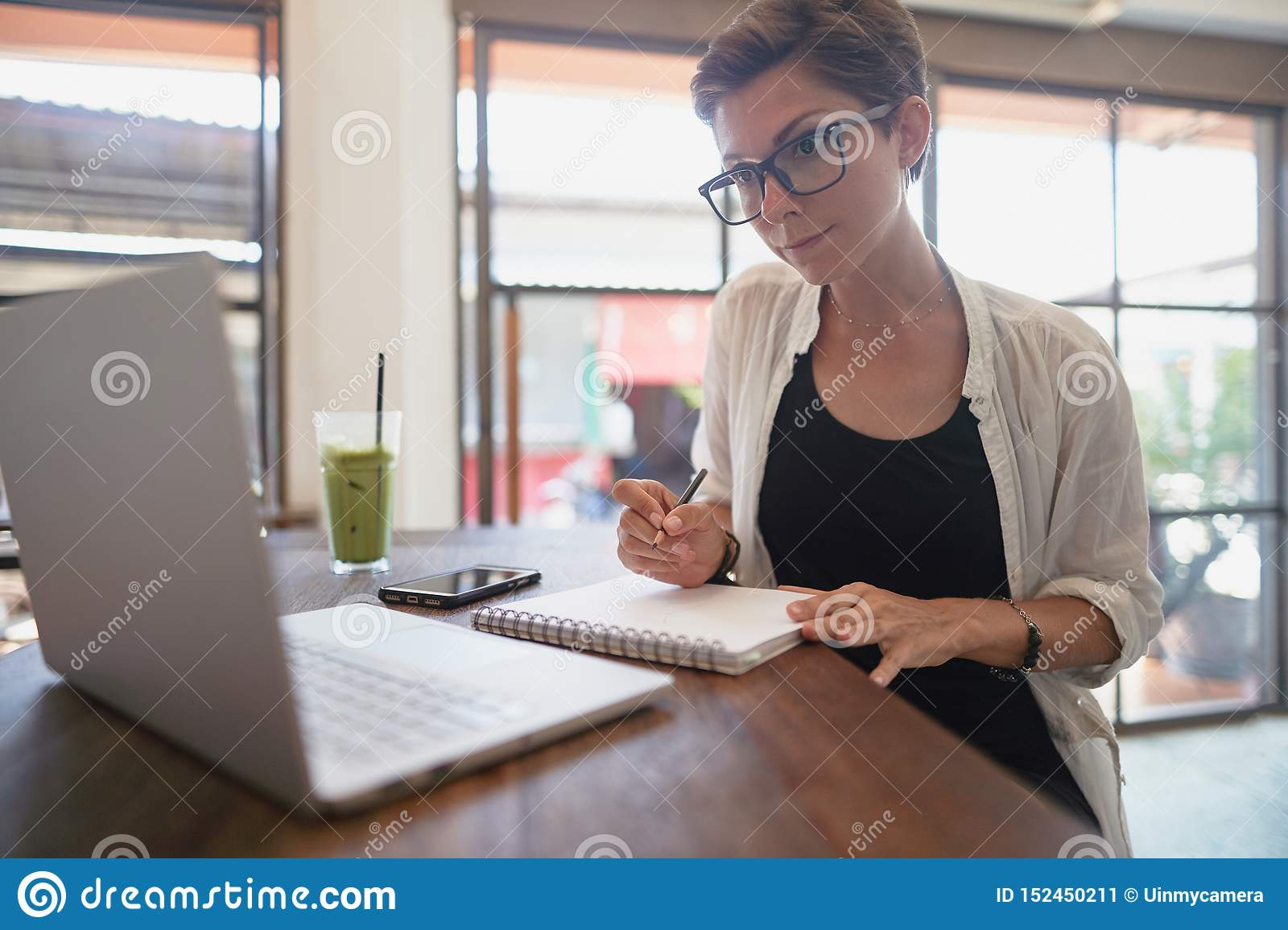 Girl working in a cafe. Freelance concept