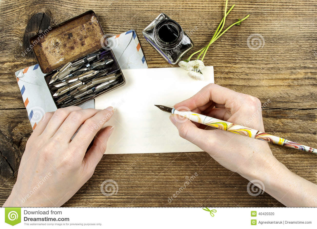 Girl writing a letter with ink pen