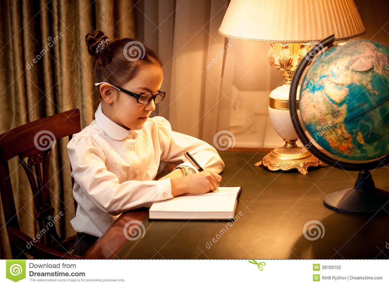 Schoolboy Looking At Girl While Writing At Desk