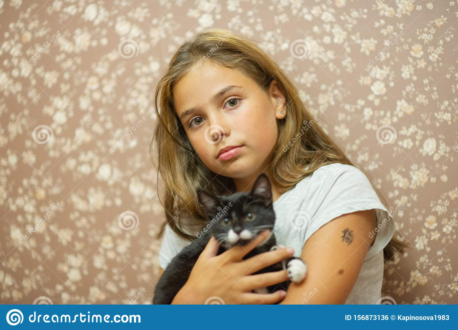 Girl 10 Years Old And A Black And White Kitten Stock Photo Image Of Care Nature 156873136