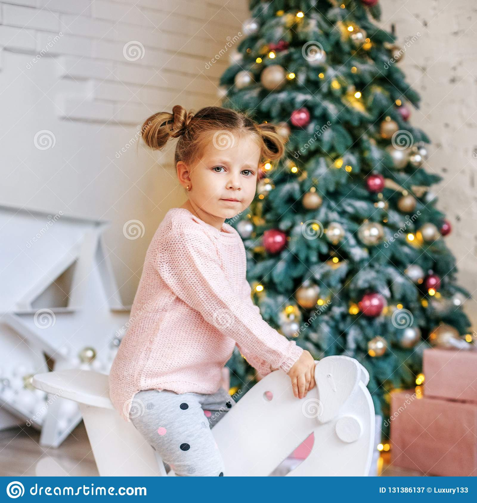 Girl 3 years old riding a horse. Concept New Year, Merry Christm