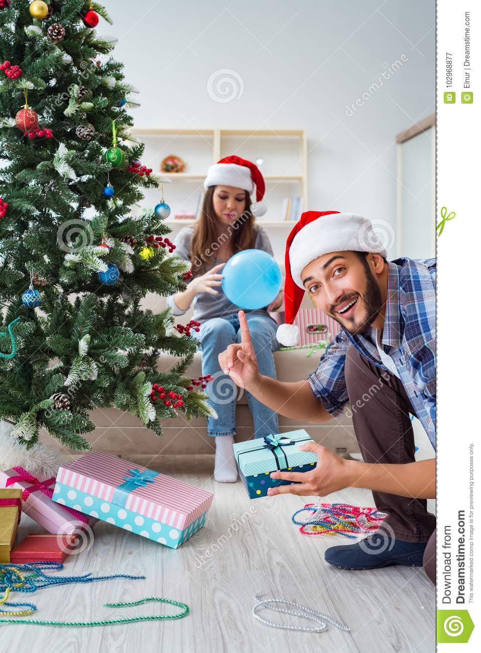 The Girlfriend And Boyfriend Opening Christmas Gifts Stock Image ...