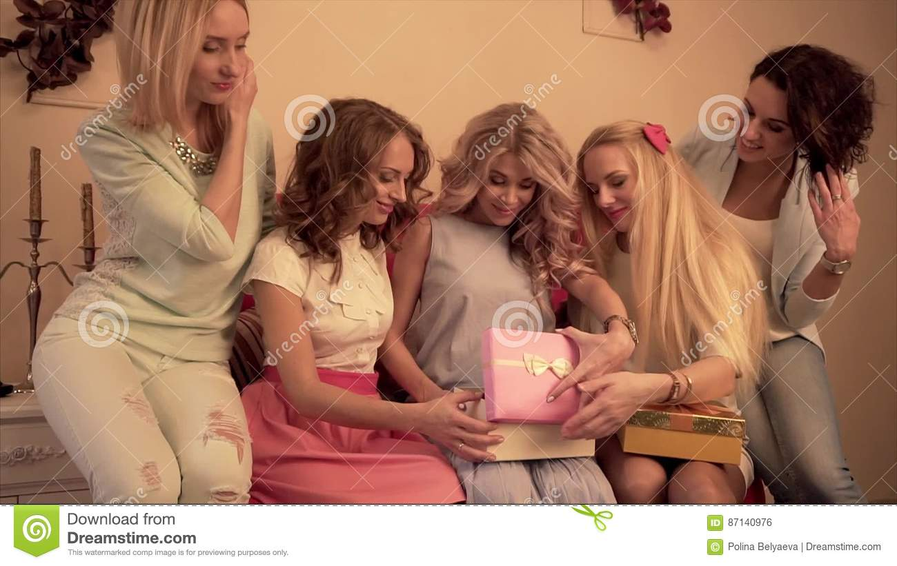 Girlfriends At The Babyshower Party Give Gifts To The Close Friend