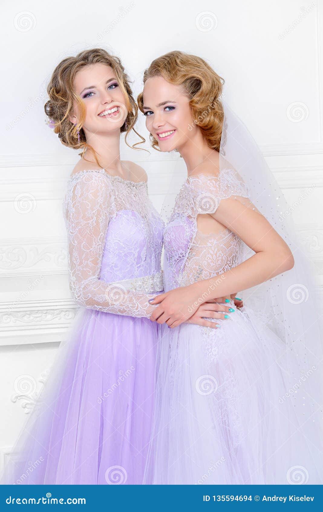 Girlfriends in wedding dresses