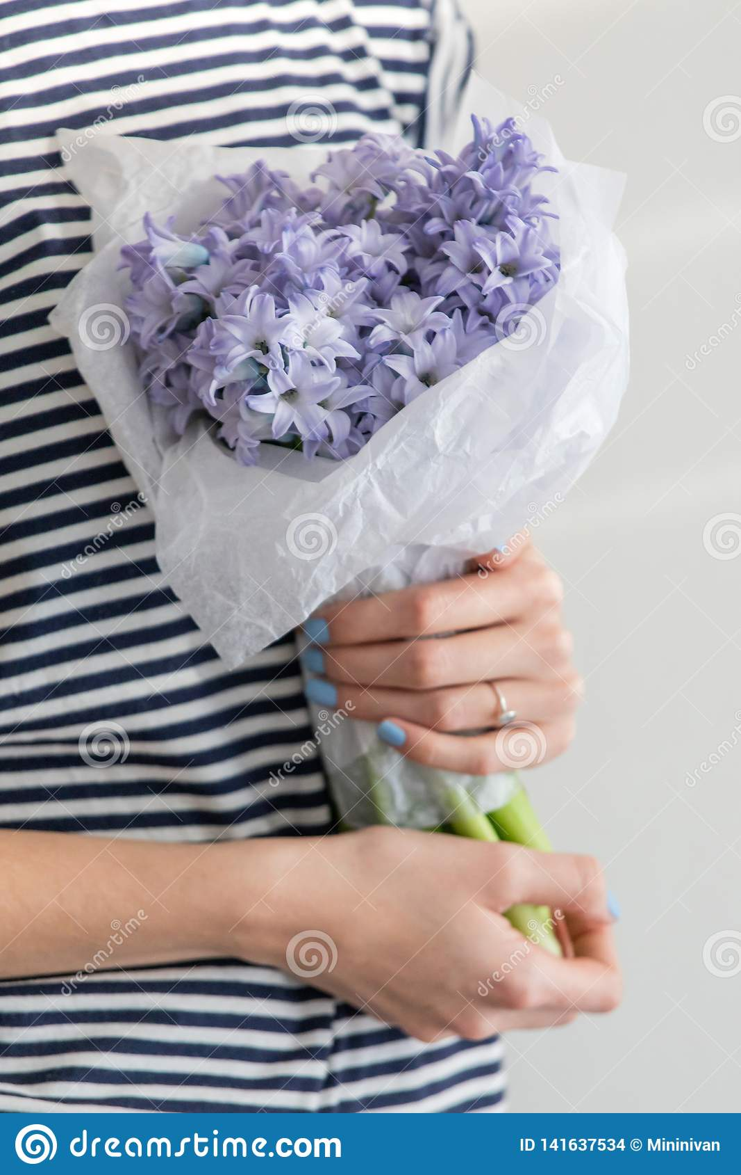 GirlHolding Little Bouquet Of Flowers Hyacinths