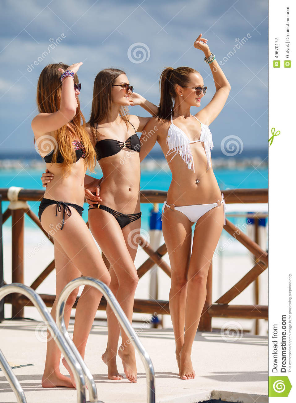 girls in bikini relax on the background of the ocean