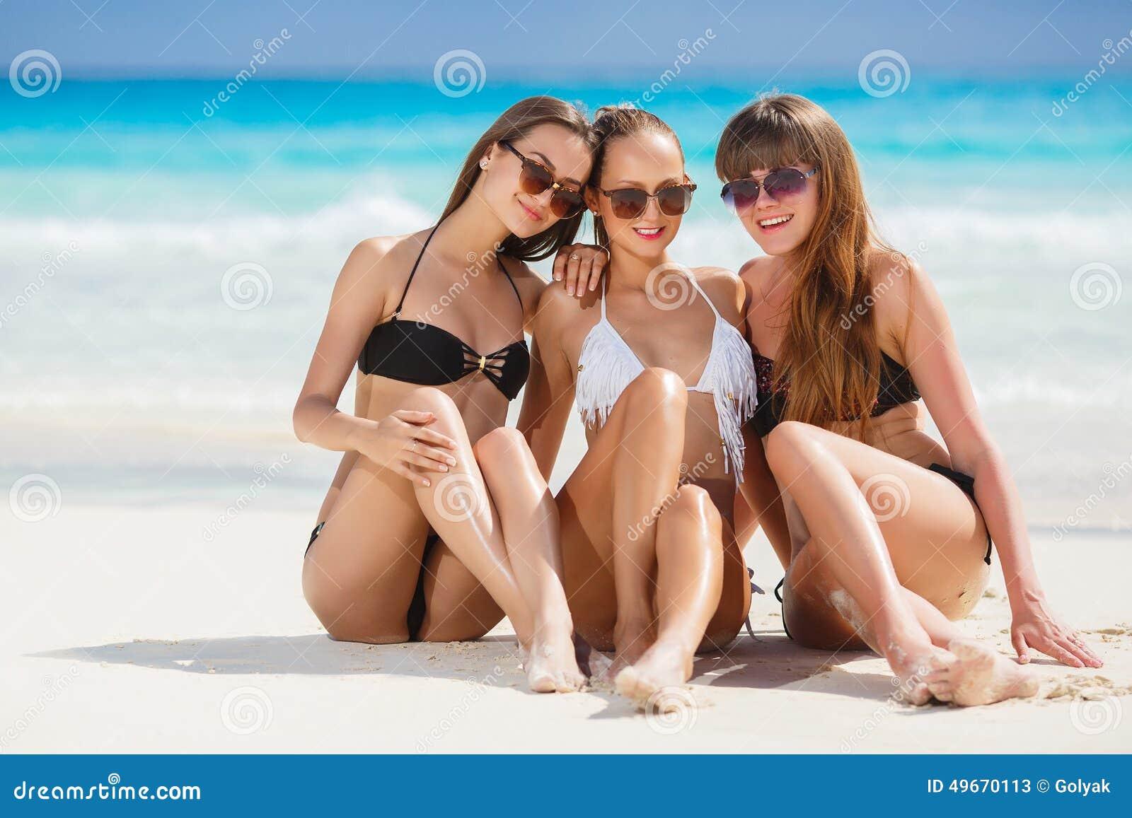 girls in bikinis sunbathing  sitting on the beach stock Beach Sun Clip Art Eating Clip Art