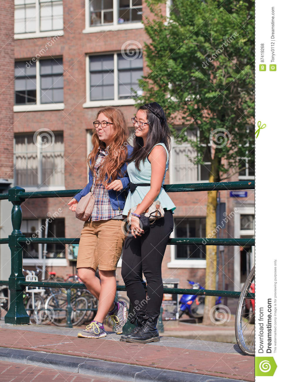Girls on a bridge in the ancient canal belt, Amsterdam, netherlands