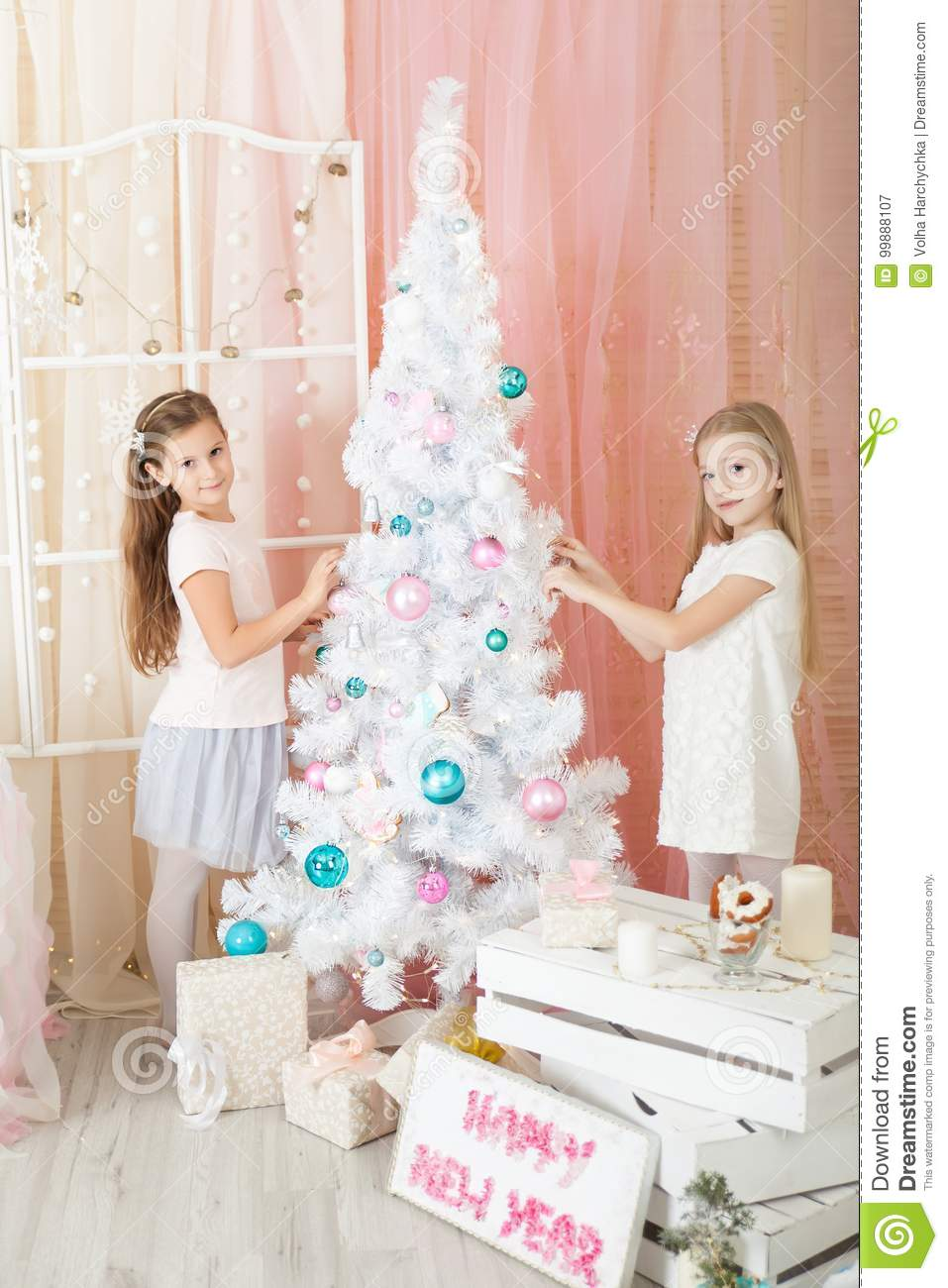 girls in a christmas decorated studio in pastel colors