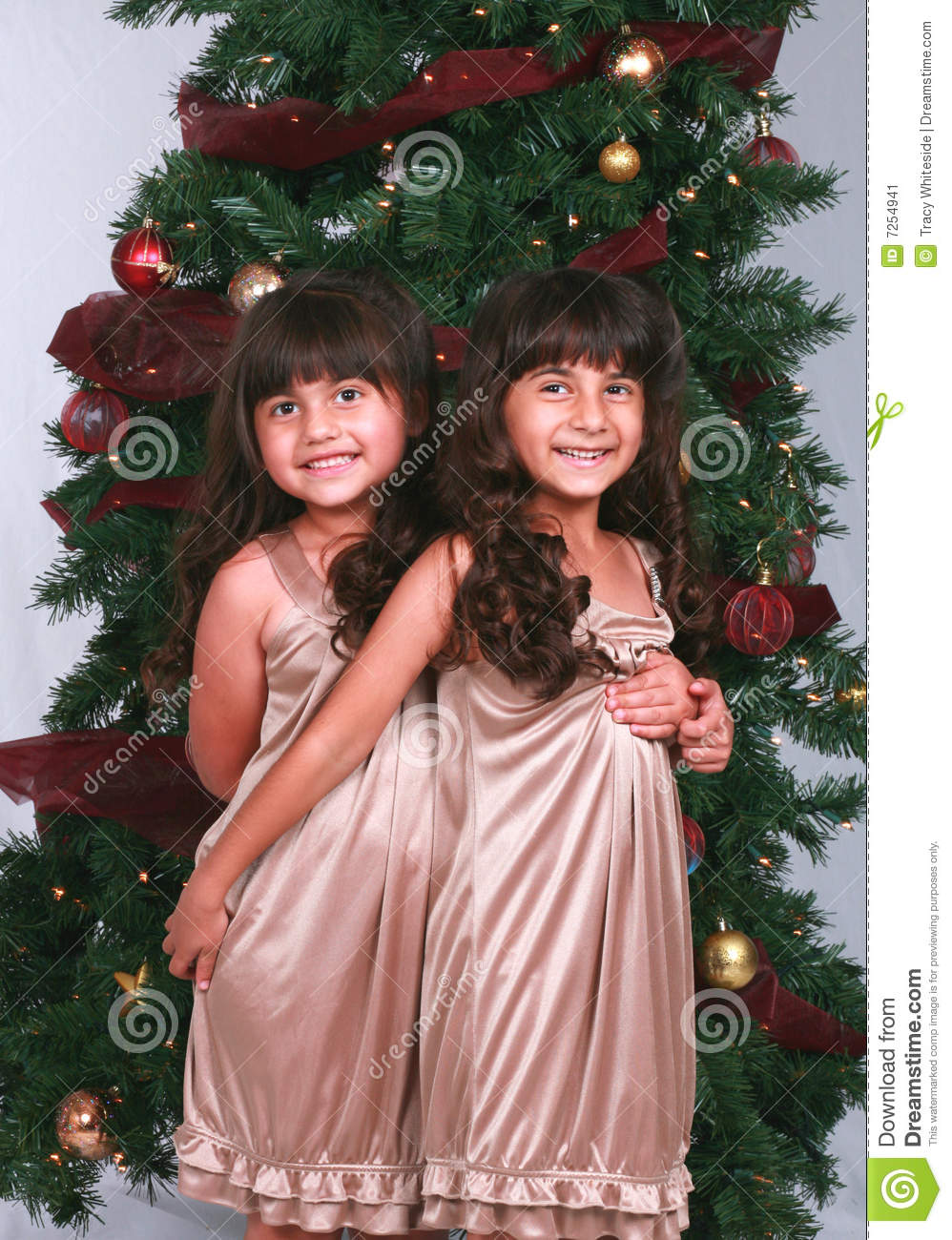 Girls by Christmas Tree