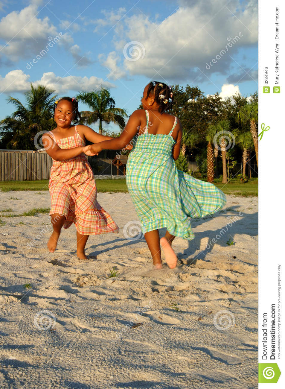 Girls dancing on sand at beach