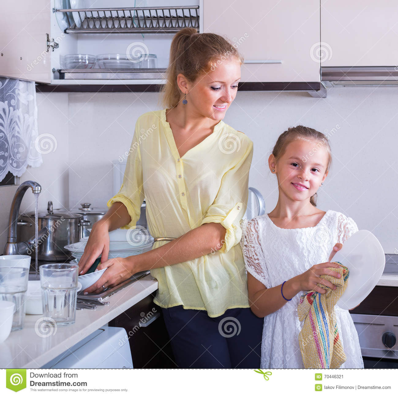 Happy Girl Kitchen: Girls Doing And Wiping Dishes In Kitchen Stock Image