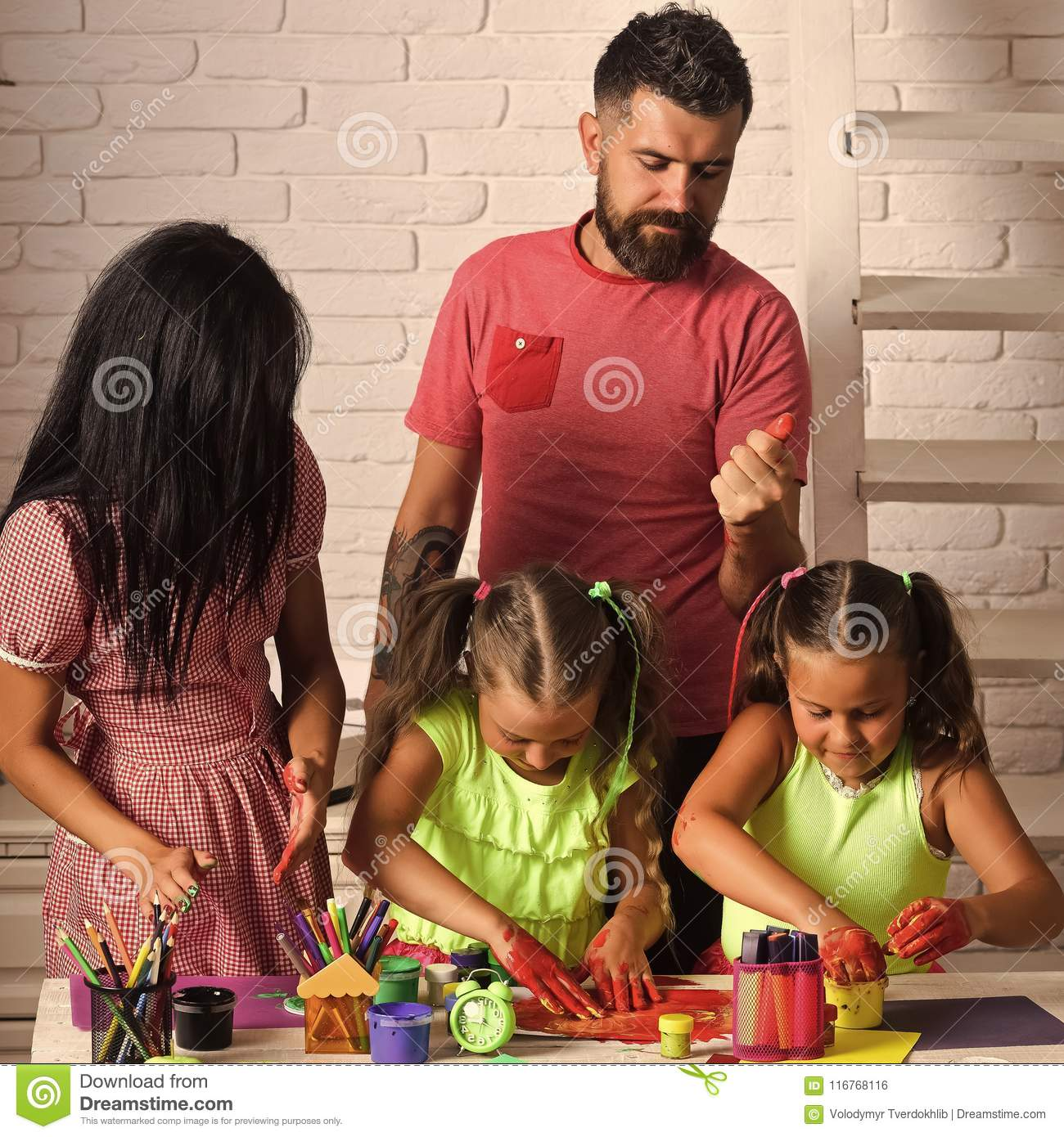 Girls Drawing With Mother And Father Happy Childhood And Parenting Imagination Creativity Concept Finger Painting And Arts