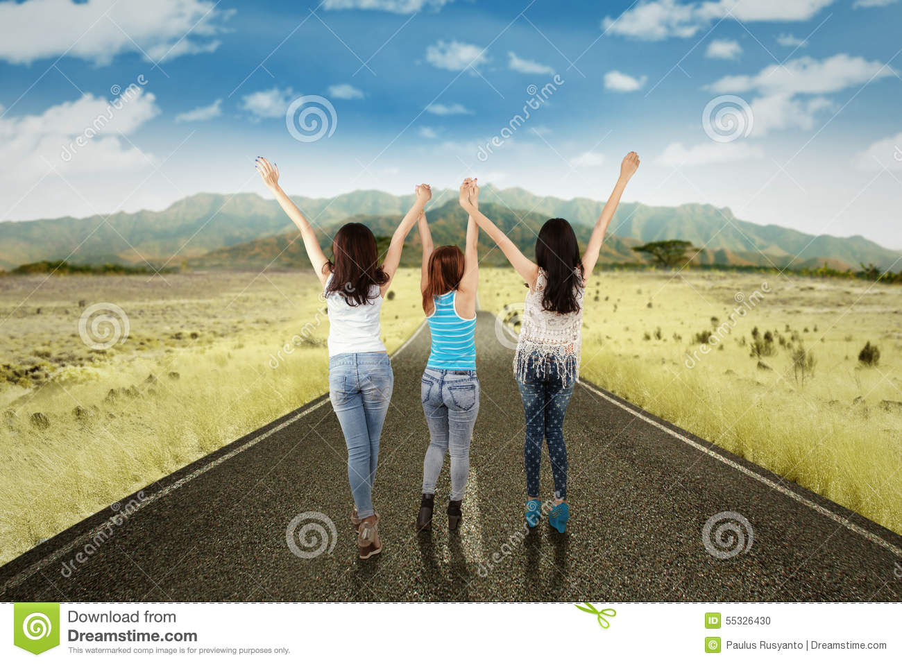 Girls Enjoy Freedom On The Countryside Road Stock Photo