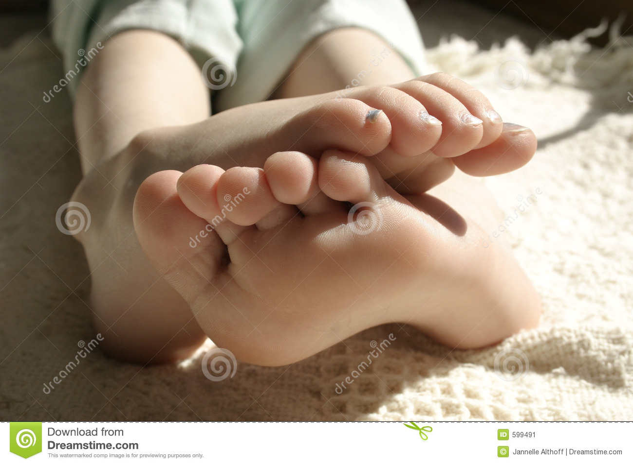 Little girl resting feet.