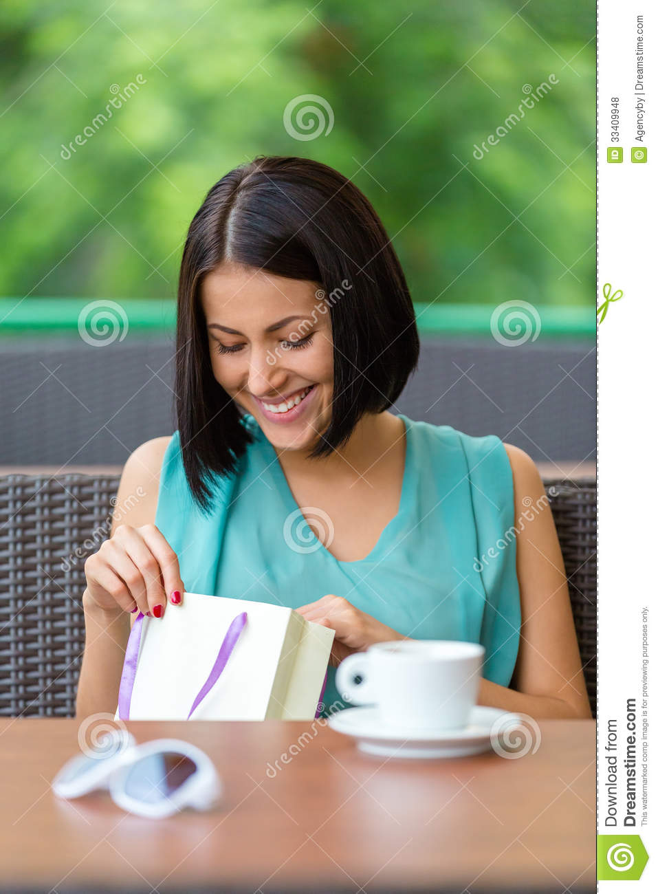 Girls Gets Present Sitting At The Cafe Stock Photo Image
