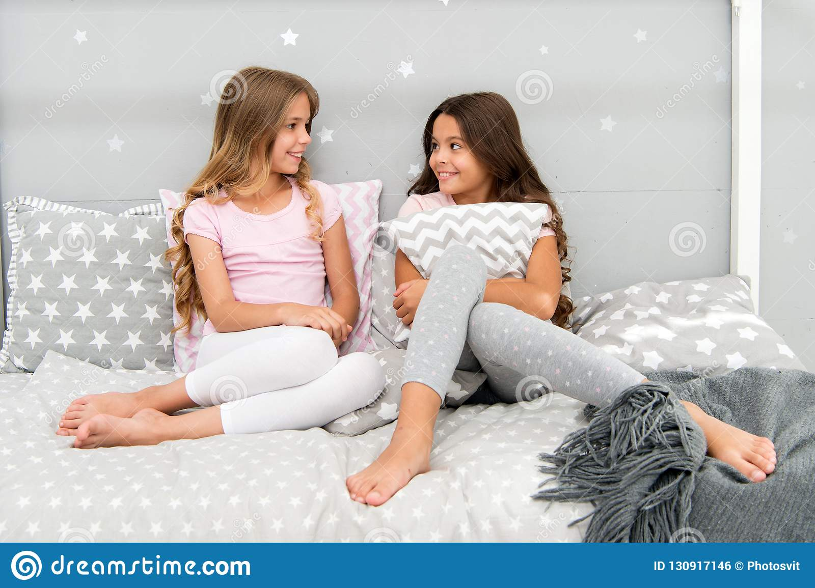 06dc649177 Girls happy best friends or siblings in cute stylish pajamas with pillows  sleepover party. Sisters having fun sleepover party. Pillow fight pajama  party.