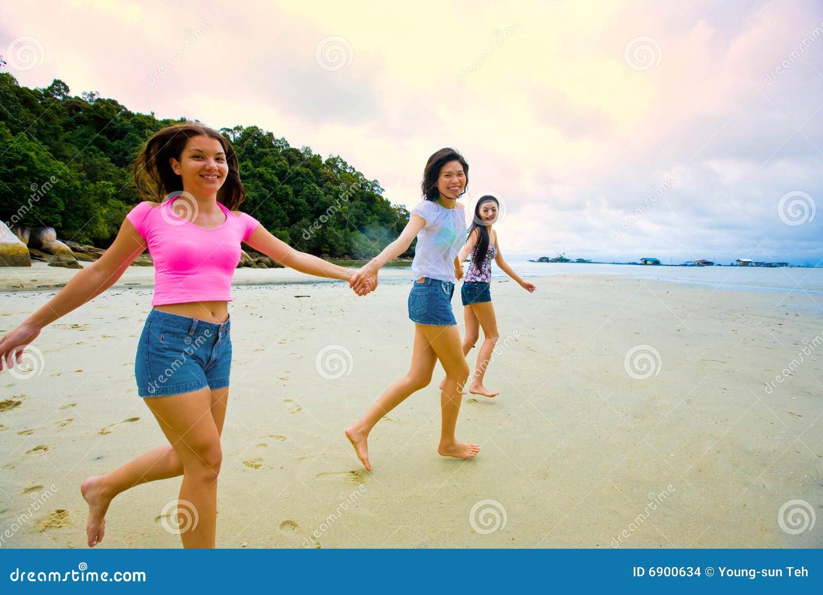 girl gives handjob at nude beach
