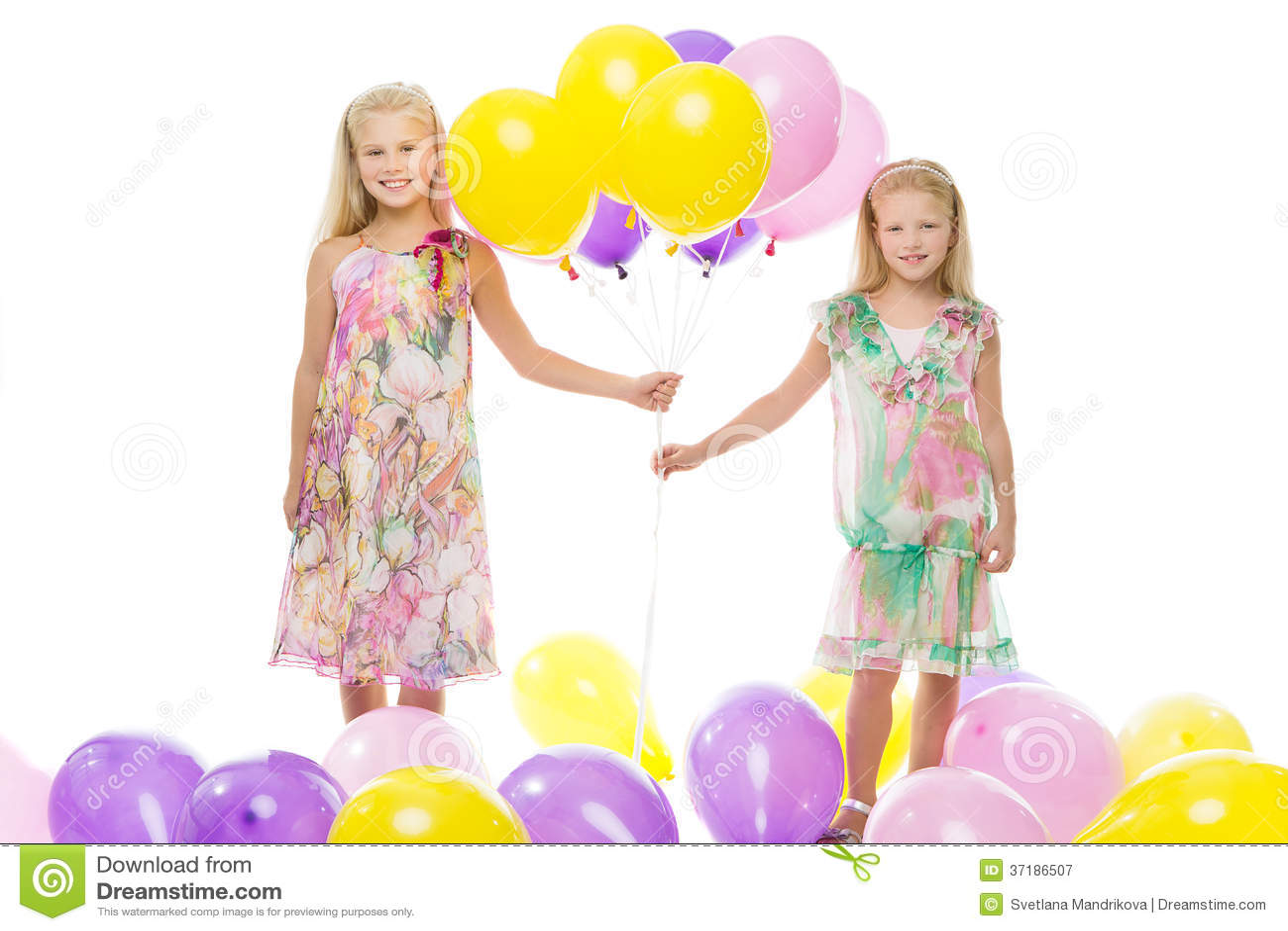 Girls holding balloons