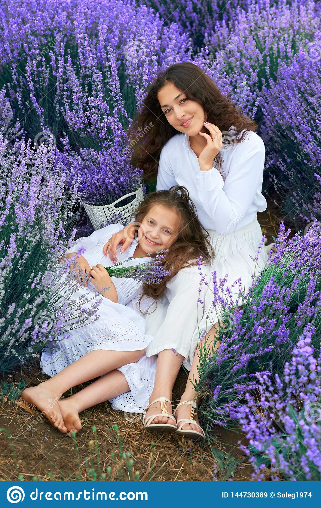 Girls are in the lavender flower field, beautiful summer landscape