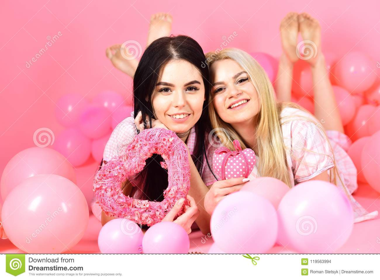 Blonde and brunette with toys