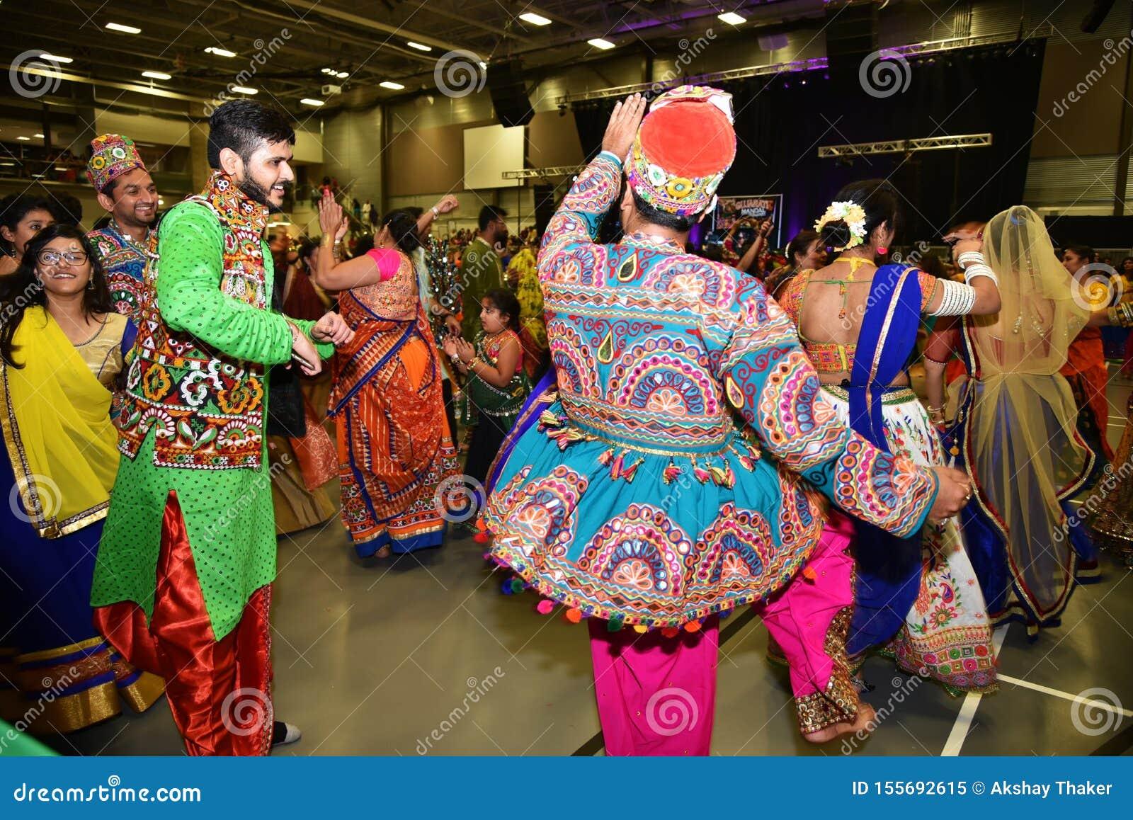 Girls Man Women Are Performing Garba And Dandiya Dance Wearing Traditional Indian Folk Dress During Navratri Festival Canada Editorial Image Image Of Celebration Also 155692615