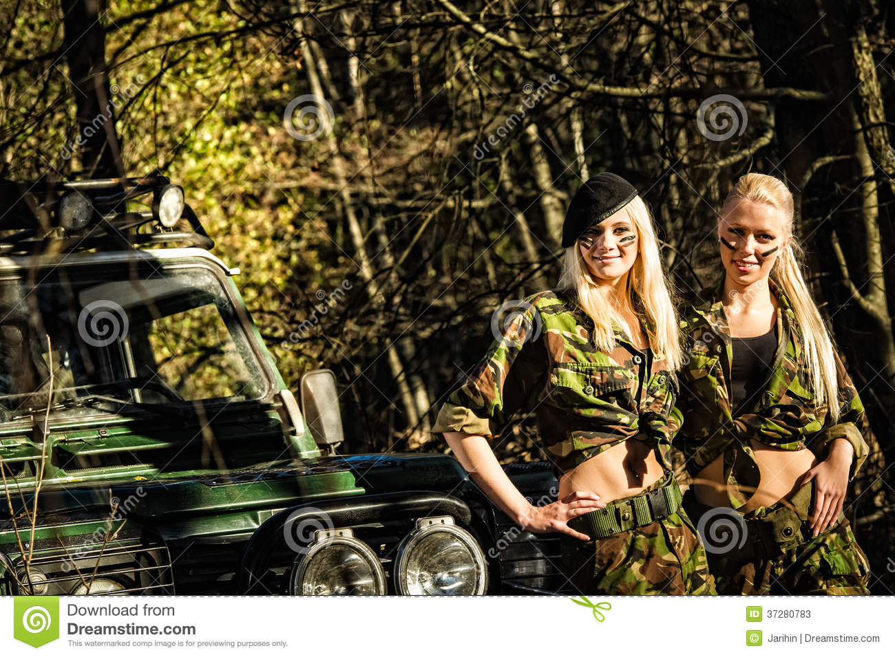 Beautiful girls on camouflage outfit, teamwork and off-road vehicle.