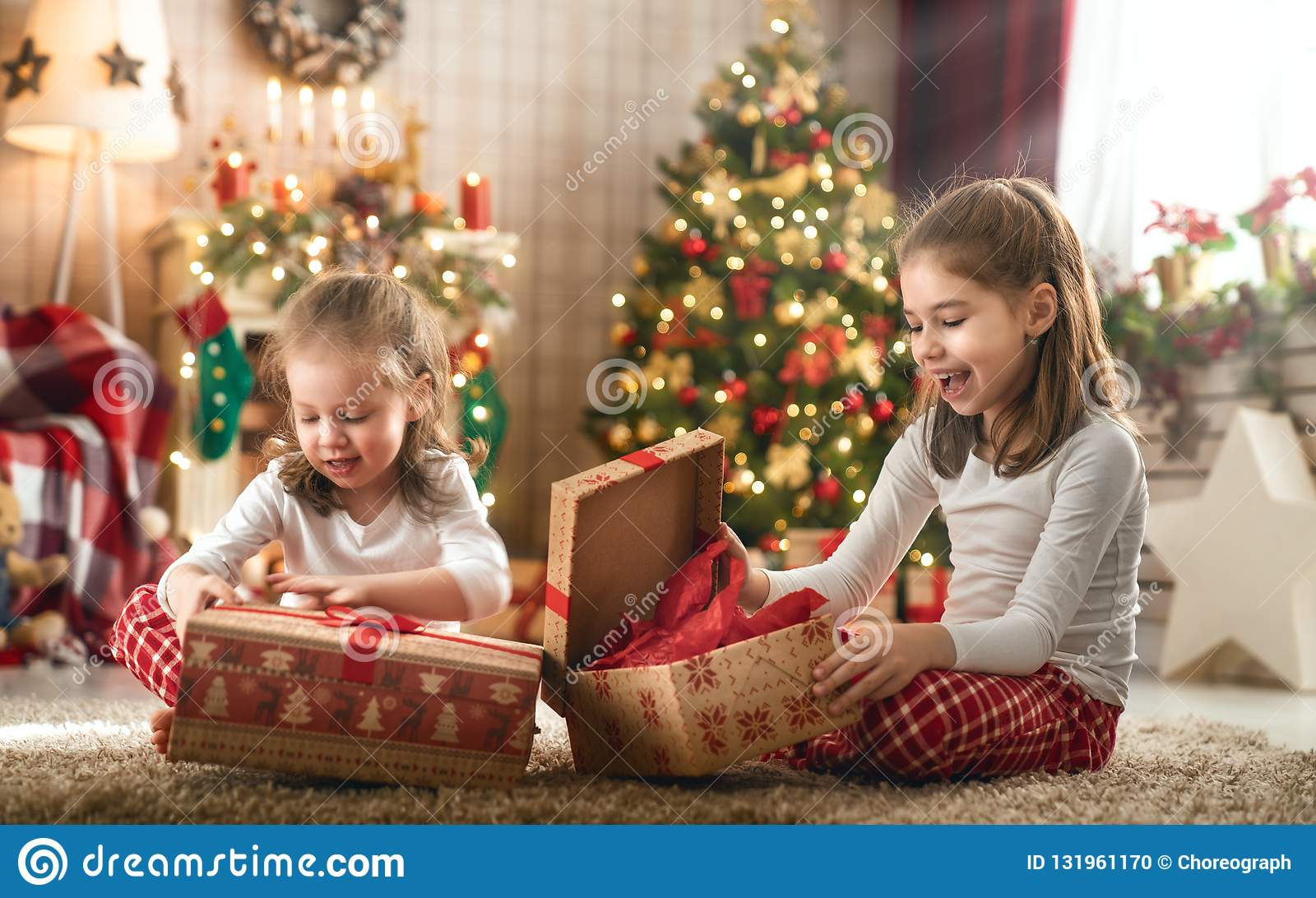 Christmas Gifts For Kids.Girls Opening Christmas Gifts Stock Photo Image Of Present