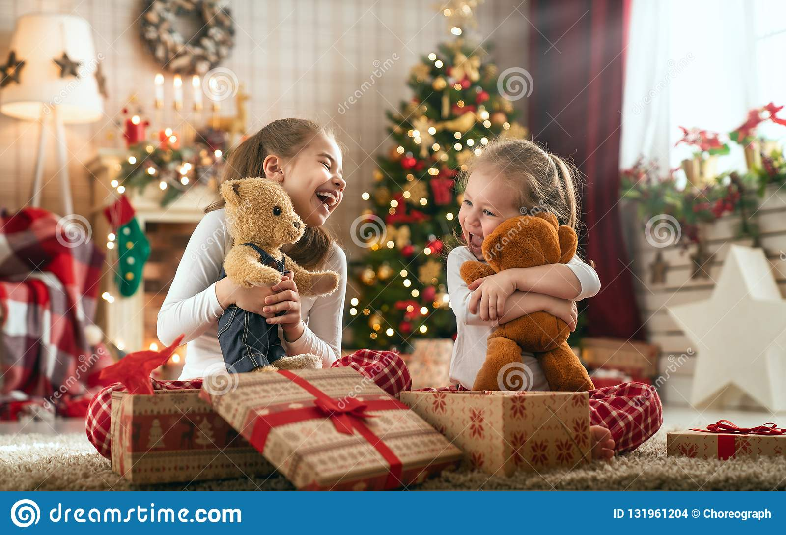 Girls Opening Christmas Gifts Stock Photo - Image of gift, family ...