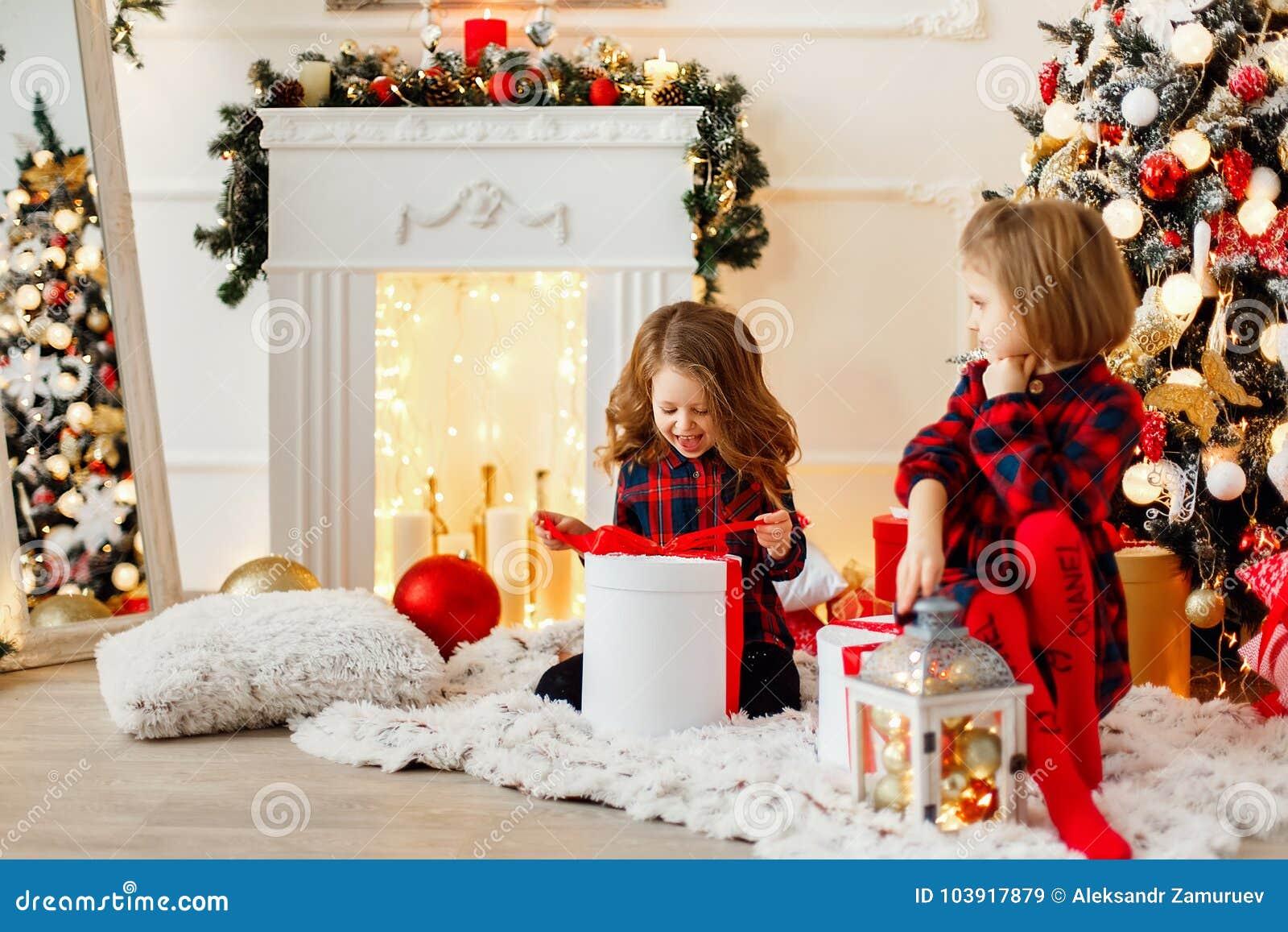 Girls opening Christmas presents