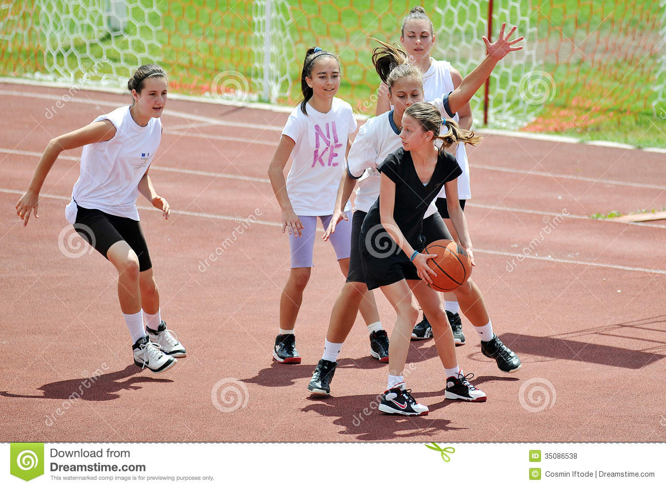 A Woman Playing Basketball Imágenes De Stock A Woman: Girls Play Basketball Outside Editorial Stock Photo