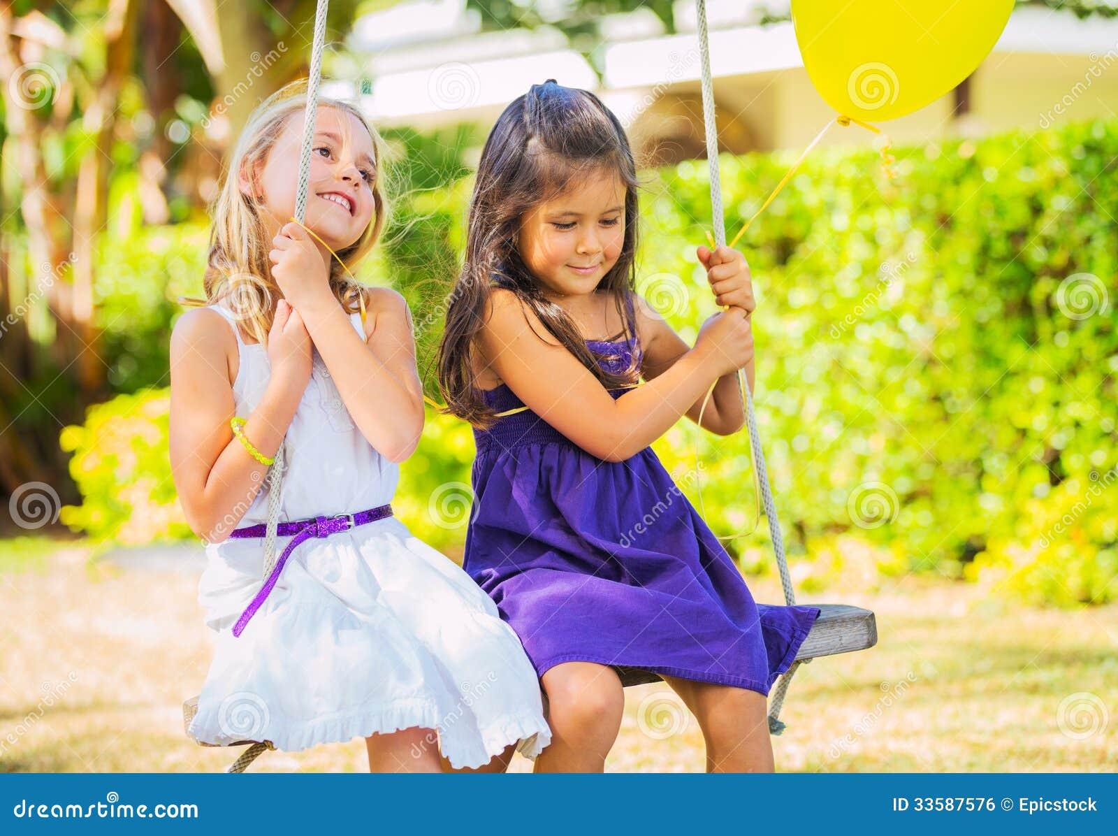 Girls Playing on Swing