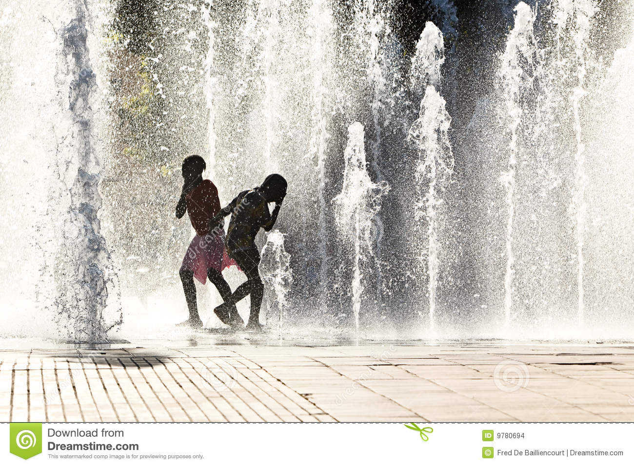 Girls playing in water jets
