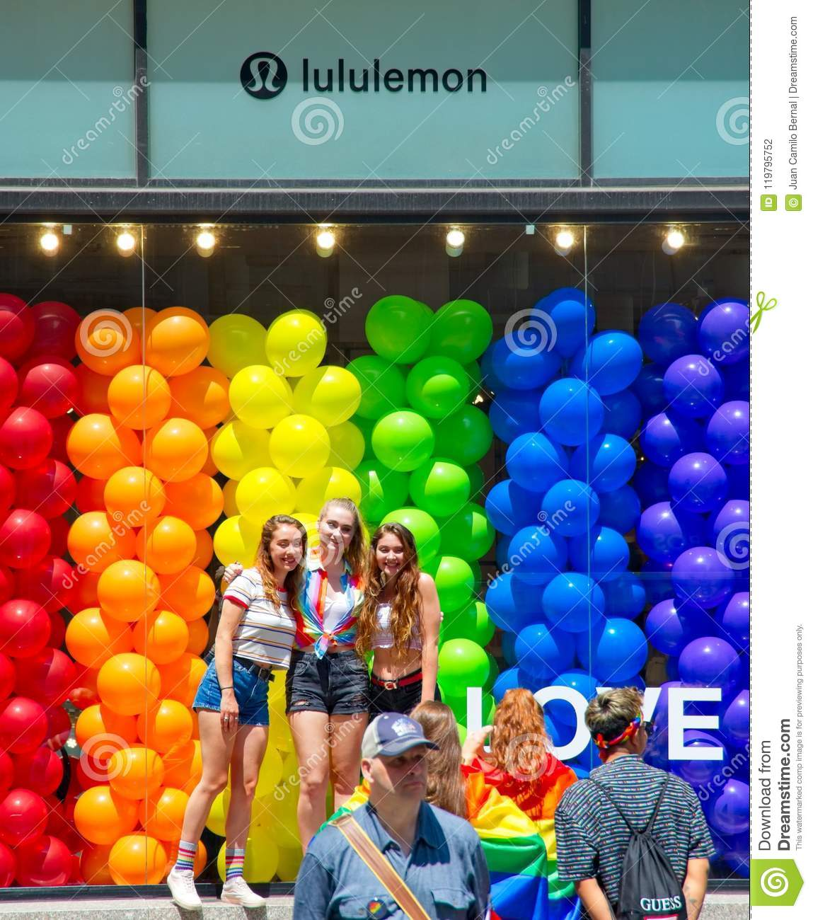 Girls posing in front of the Lululemon during the 2018 New York City Pride Parade.