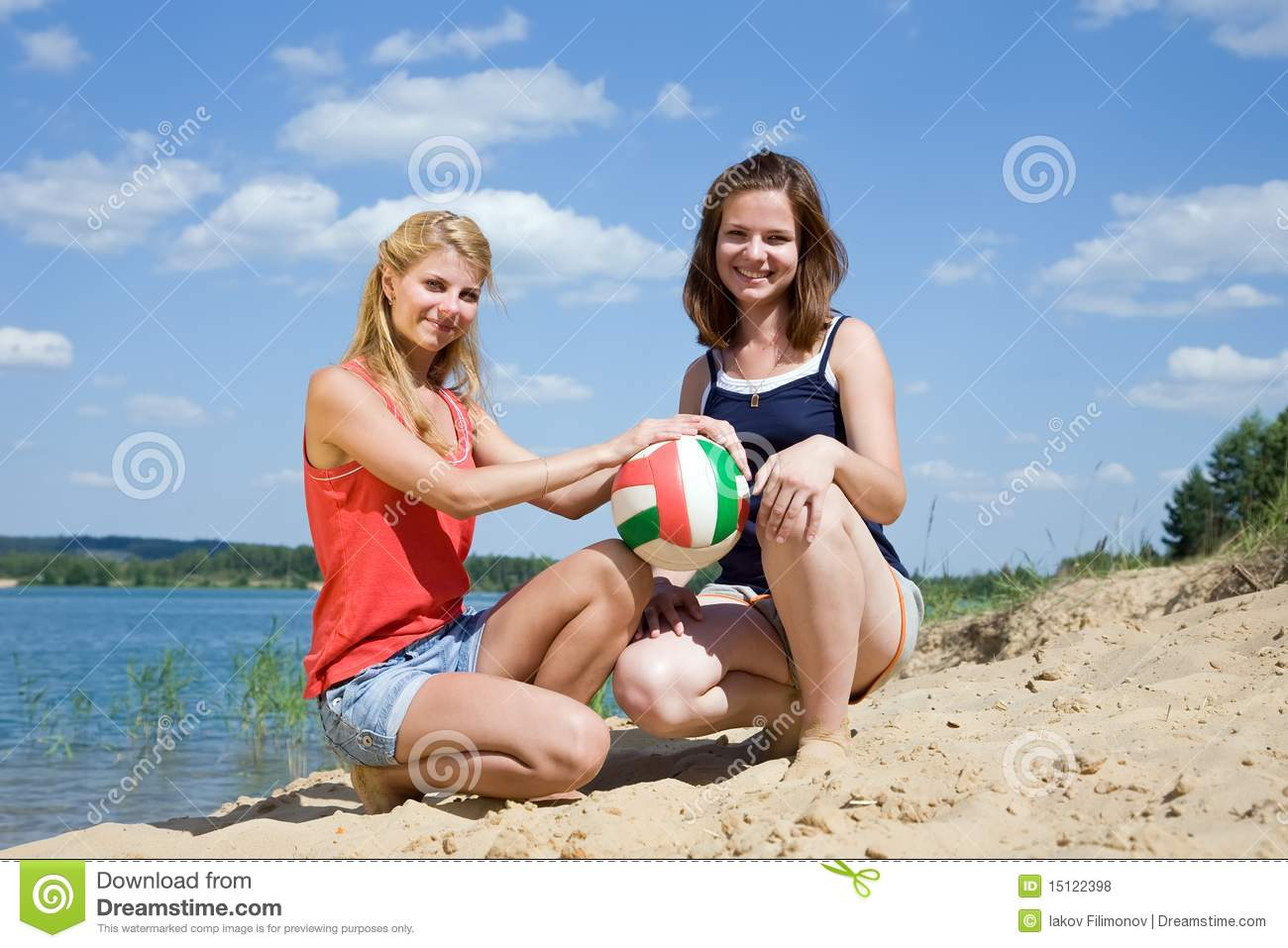 girls posing with volleyballs