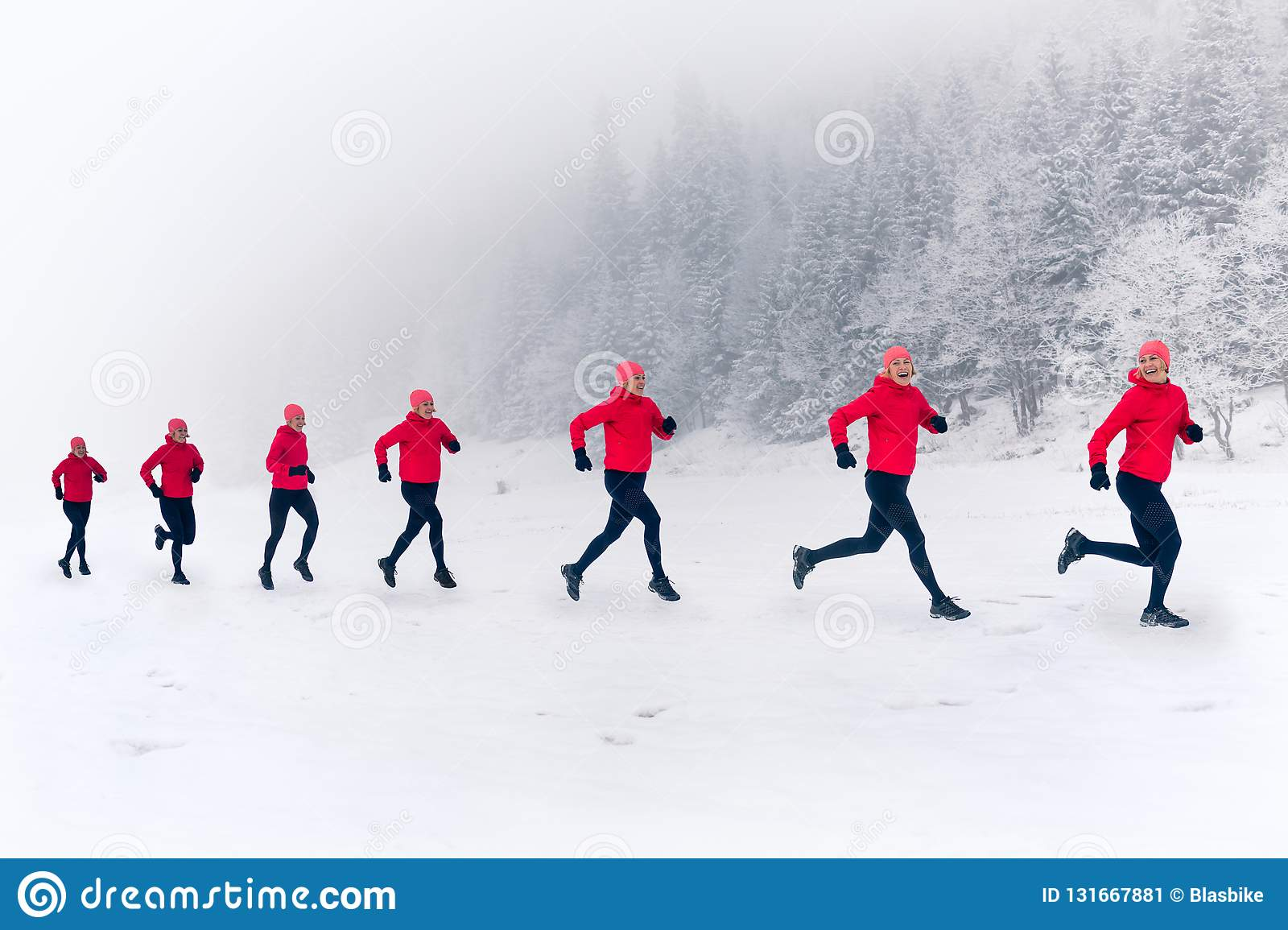 Girls running together on snow in winter mountains. Sport, fitness inspiration and motivation. Happy group of women trail running