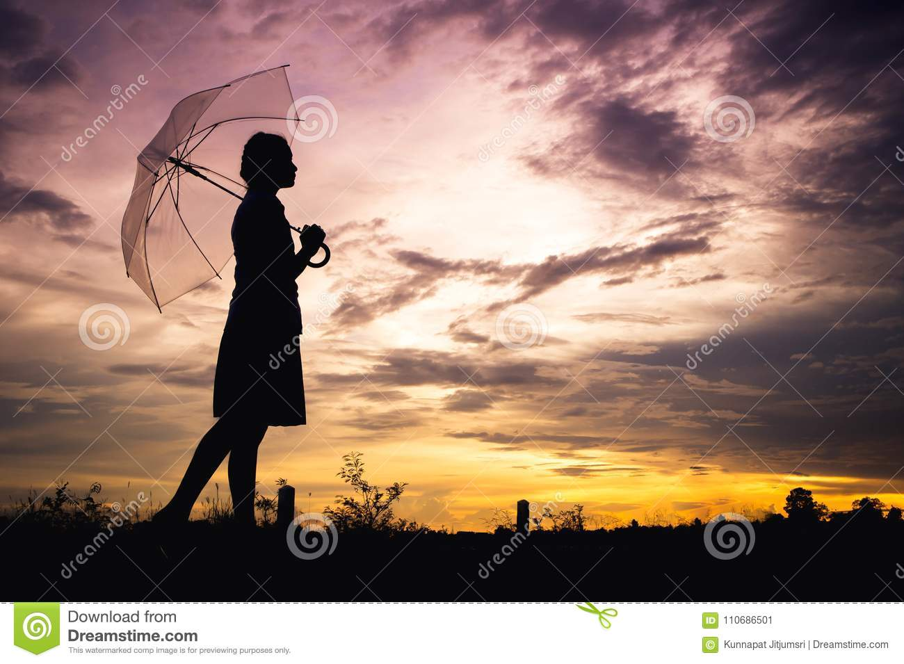 The girls silhouette style walking alone outdoor and umbrella in