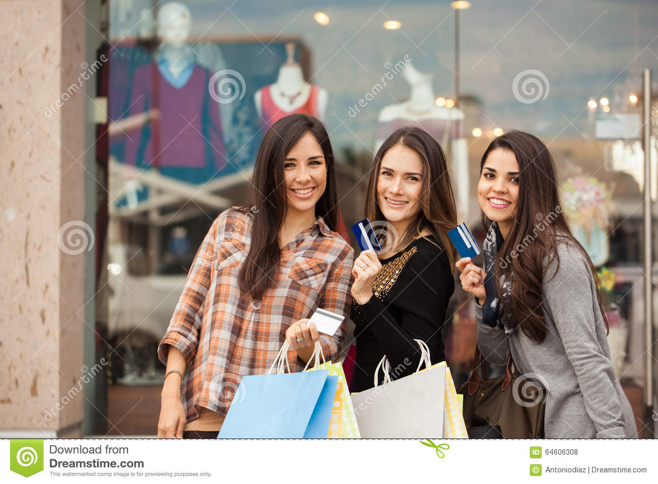 Girls Spending Money At A Shopping Mall Stock Photo Image 64606308