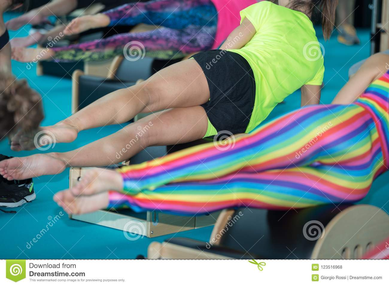 Remarkable Girls In Sportswear Doing Fitness Exercises On Little Wooden Theyellowbook Wood Chair Design Ideas Theyellowbookinfo